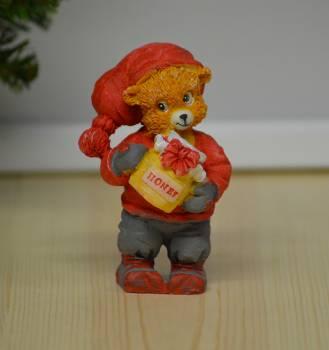 Julebamse stående med honningkrukke