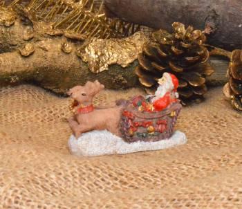 Julemand med Rensdyr og kane